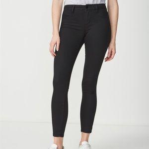 5561e980de2ed2 Cotton On Jeans | Black Mid Rise Jegging Size 12 | Poshmark